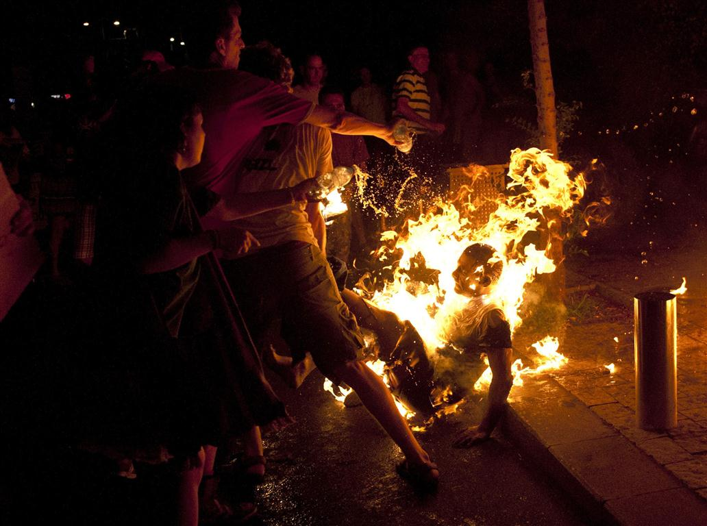 protesters_try_to_extinguish_flames_from_a_protest_50020607ec